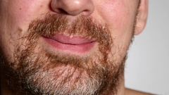 Closeup Of A Bearded Man Mouth Smile On White Background Stock Footage