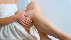 Closeup slow motion footage of sexy woman apply moisturizing lotion on legs Stock Footage