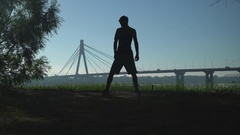 Fit man doing a warm up before running Stock Footage