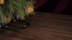 Christmas garland on the fir tree branches. Tree branches close up, shift motion Stock Footage