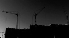 Original monochrome video motion cranes during construction of a house. timelaps Stock Footage