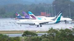 SilkAir airways Boeing 737 landing in Phuket International Airport Stock Footage