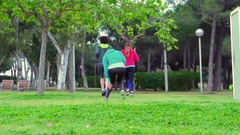 Woman running with friends and having muscle cramp, steadycam shot, slow motion  Stock Footage