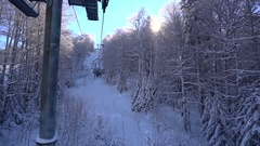 Snow forest and skiers on a ski lift pov Stock Footage