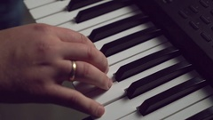 Male hand plays on synthesizer keyboard Stock Footage