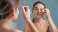 Closeup footage of beautiful young woman plucking eyebrows with tweezers Stock Footage
