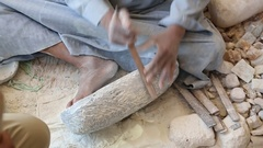 Anonymous worker cutting something from stone material Stock Footage