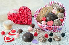 , Basket with sweets and biscuits on the table, decorative Valentine day heart Stock Photos