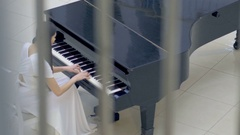 Musical pianist playing classical grand piano in a center of concert hall Stock Footage