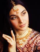 Beauty sweet real indian girl in sari smiling on black backgroun Kuvituskuvat