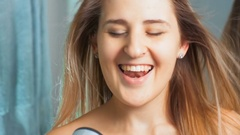 4K footage of beautiful young woman singing at hair dryer at bathroom Stock Footage