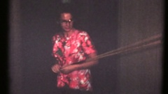 Vintage 8mm home movies,Mom playing billiards at family get together Stock Footage