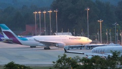 Qatar Airways airplane drives on airfield at the evening Stock Footage