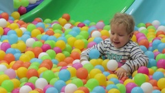 Boy playing with colored balls Stock Footage