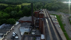 Drone shot of a old industry chimney in Manchester, England, wide Stock Footage
