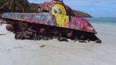 Old rusted military tank on flamenco beach, culebra, Puerto rico Stock Footage
