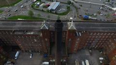 Drone shot of a old industry chimney in Manchester, England, down Stock Footage