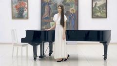 4K Professional Pianist portrait near Grand Piano Stock Footage