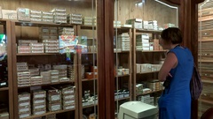 Girl considering a showcase (humidor-room) of the cigar store. Varadero, Cuba Stock Footage