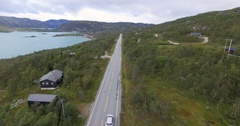 Drone shot of a car driving in beautiful Norway, right Stock Footage