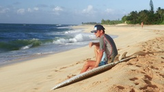 Young surfer on the beach waiting for perfect waves Stock Footage