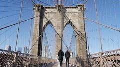 NEW YORK - JANUARY 15: Pedestrians walk over the Brooklyn Bridge, New York Stock Footage