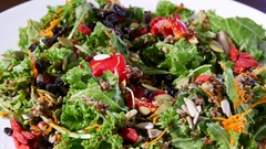 Homemade vegetarian salad in sunny garden Stock Footage