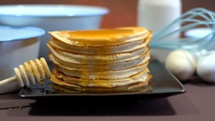 Shrove Tuesday stack of pancakes closeup with cooking utensils. Stock Footage