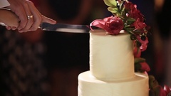 Couple splits light wedding cake Stock Footage