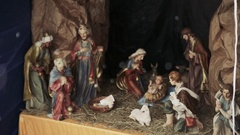 Christmas nativity scene with Mary, Joseph, baby Jesus, and animals in a stable Stock Footage
