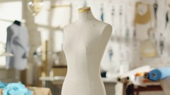 Zoom Out Shot of a Tailoring Mannequin that Stands in a Bright and Sunny Studio. Stock Footage