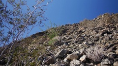 ROUGH & ROCKY DESERT TERRAIN.  ESTABLISHING SHOT. Stock Footage