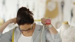 Mid Shot of a Beautiful Female Fashion Designer/ Dressmaker/ Seamstress  Stock Footage