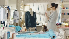 Beautiful Woman Fashion Designer Takes Photo of a Mannequin Dressed in a Blouse. Stock Footage