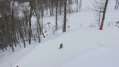 Aerial view lift of skiers and snowboarders on the ski resort Stock Footage