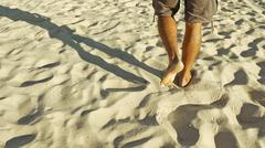 Male feet walking on sand Stock Photos