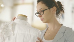 Beautiful Woman Fashion Designer Working With Tailoring Mannequin.  Stock Footage