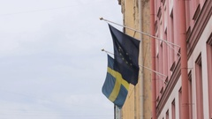 Two European flags on the building of the Consulate General of Sweden, St Stock Footage