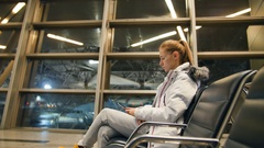 Airline passenger in an airport lounge waiting for flight aircraft Stock Footage