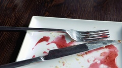 Empty plate smeared with fruit syrup Stock Footage