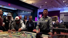 Motion of people playing casino roulette inside Hard Rock Casino Stock Footage