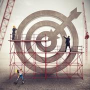 Teamwork build a business target . Mixed media Stock Photos