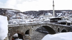 Paving stones bridge and bistrica river of prizren, Kosovo at winter season Stock Footage