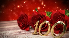 Seamless loop birthday background with red roses on wooden desk. hundredth Stock Footage