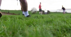 Hurling player strikes ball. Irish field game. Slow Motion Stock Footage