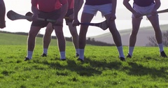 Referee throws ball to begin game of Hurling in green Irish field. Slow Motion. Stock Footage