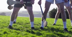 Referee throws ball to begin game of Hurling in green field. Slow Motion. Stock Footage
