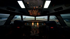 Empty workplace of aircraft pilots. Cockpit or flight deck of a modern passenger Stock Footage