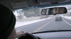 Closeup Of Man In The Rearview Mirror Of Car, He Smiles And Chats With Passenger Stock Footage