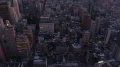 AERIAL: Colorful lights on New York streets in Manhattan downtown at golden dusk Stock Footage